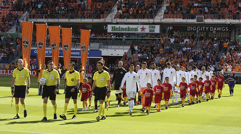 Houston Dynamo and Los Angeles Galaxy enter the pitch before the opening day game at BBVA Stadium.
