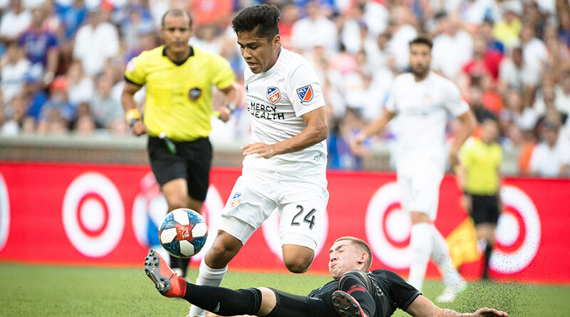 Baldomero Toledo watches a a tackle during an MLS game