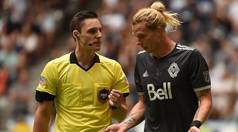 Joe Dickerson calms down a Vancouver Whitecaps player