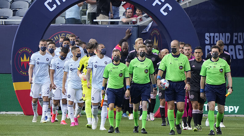 PRO officials lead out Chicago Fire and Inter Miami at Soldier Field.