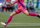 Goalkeeping kicking a ball