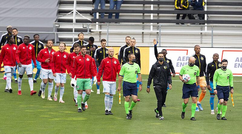 Columbus Crew SC and Toronto FC enter the field prior to the match at Historic Crew Stadium.