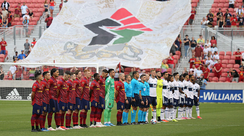 The crew standing on the field with the players ahead of Real Salt Lake against Vancouver Whitecaps.
