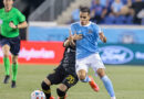 New York City FC forward Jesus Medina (19) fights for the ball against against Columbus Crew midfielder Alexandru Matan (20) during the second half at Red Bull Arena.