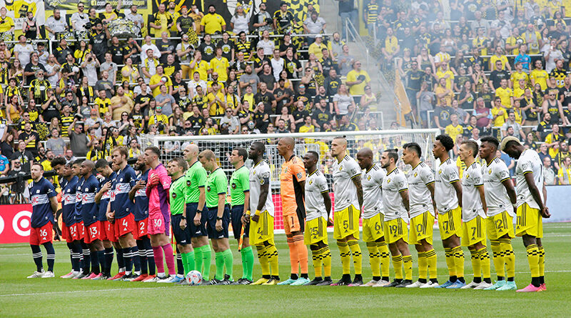 PRO officials standing with the players before Columbus Crew take on New England Revolution in MLS.