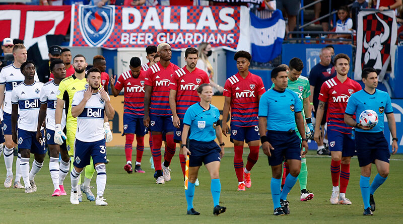 PRO officials Jennifer Garner, Elton Garcia, and Ramy Touchan lead Vancouver Whitecaps and FC Dallas onto the field.