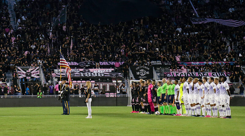 The officiating crew stands alongside players of Inter Miami and Orlando City at DRV PNK Stadium.